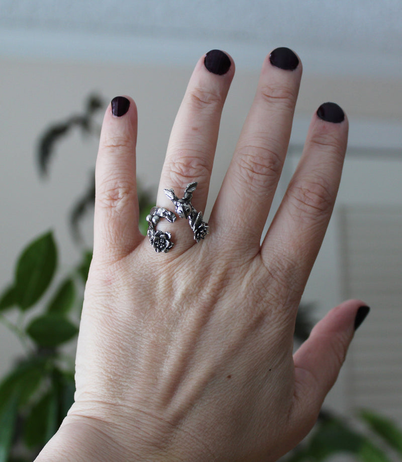 A photo of the silver ladybug ring being worn on a hand for size reference.