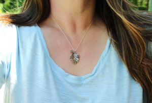 sterling silver monstera deliciosa necklace being worn-The Striped Cat Metalworks- Botanical Jewelry