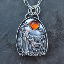 Load image into Gallery viewer, The Striped Cat Metalworks created a one of a kind sterling silver moose pendant with a mother and baby moose shown in a grassy swamp all made from sterling silver with a natural amber stone.