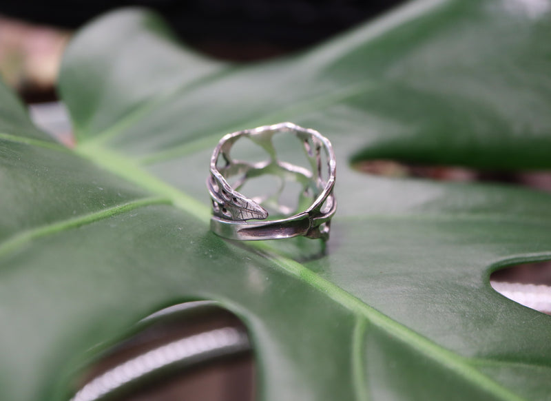 The back view of the handmade sterling silver monstera obliqua leaf ring.