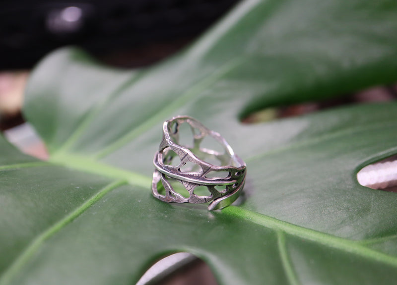 Another side view of the holey, real leaf patterned, monstera obliqua leaf ring.