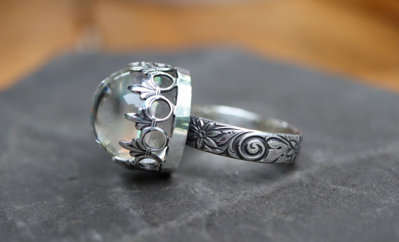The side of a white opal ring made with glass and sterling silver.