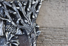Load image into Gallery viewer, A close up of one of the trees in the Princess Mononoke pendant showing lots of tiny leaves and tree branches.
