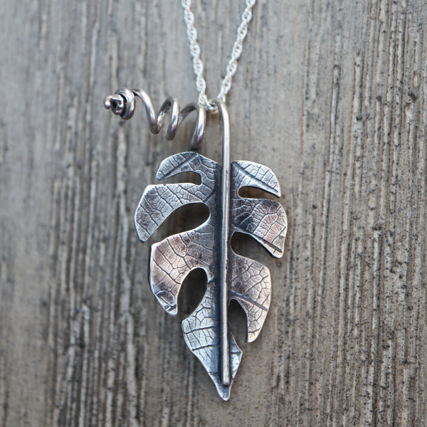 Rhaphidophora tetrasperma necklace made from sterling silver and shown on a necklace.