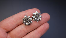 Load image into Gallery viewer, A hand holding a pair of sterling silver succulent earrings to show size reference. They are about 1 in tall.