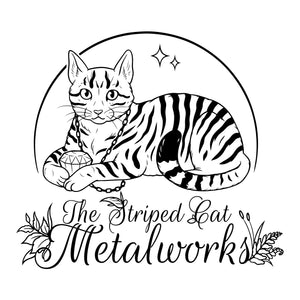 A gift certificate gift card for The Striped Cat Metalworks.