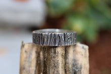 Load image into Gallery viewer, A recycled sterling silver tree bark ring handmade by The Striped Cat Metalworks. The ring is pictured on top of a pumpkin stem.