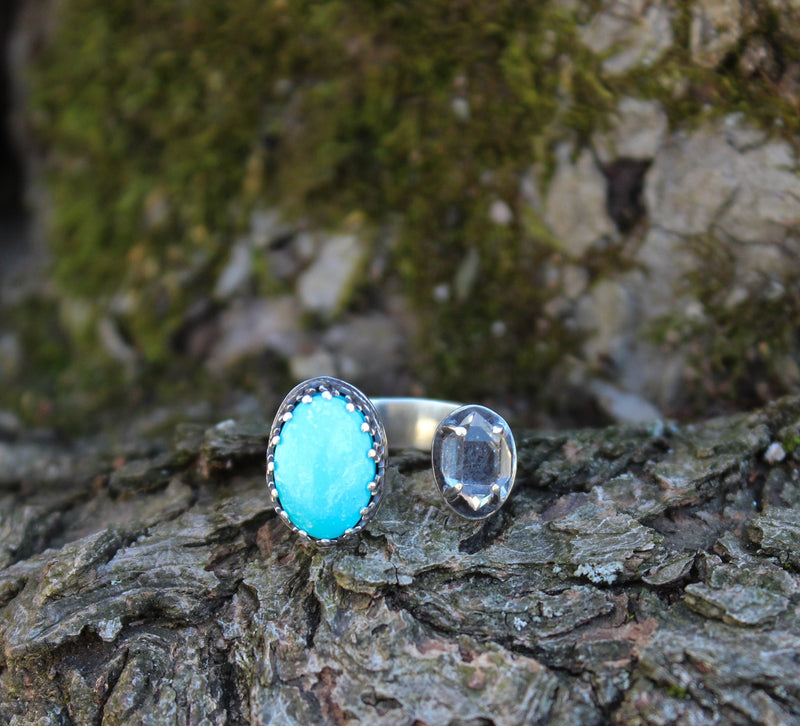 A front view of the herkimer diamond and Kingman turquoise adjustable ring.