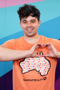 Damien Haas wears official Smosh Merch. Smoshstralia short-sleeved tee.