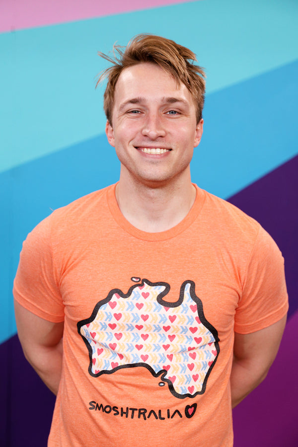 Shayne Topp wears official Smosh Merch. Smoshstralia short-sleeved tee.