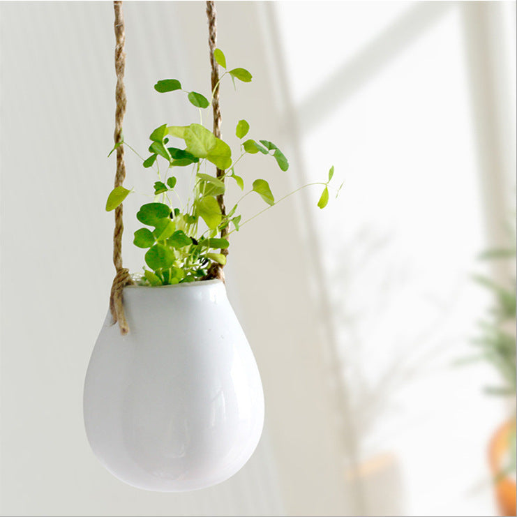 AIBEI-ZAKKA Ceramic White Hanging Flower Pot Japanese Style Cute Small Egg floret bottle Vertical Garden Pots