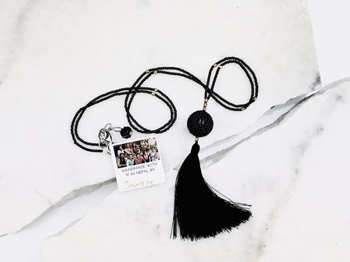 $36 Globe Tassel Necklace