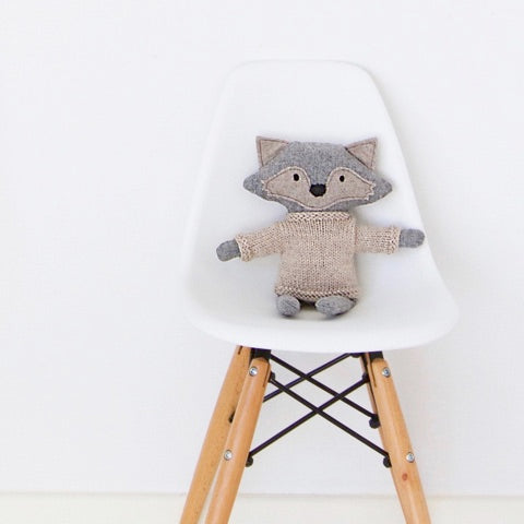 and the little dog laughed heiko the fox sitting on white chair with wooden legs