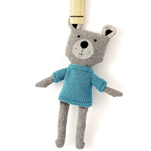 and the little dog laughed basil bear hanging on wooden peg
