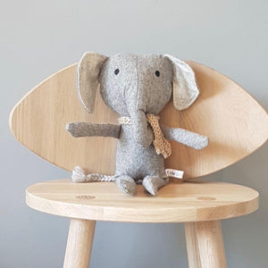 and the little dog laughed barnaby the elephant sitting on wooden chair
