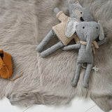 and the little dog laughed barnaby the elephant and heiko the fox laying on fur rug