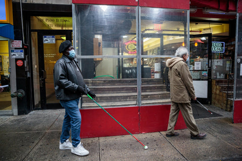 Blind men using canes on NYC street
