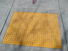 truncated domes ADA warning tiles embedded in sidewalk