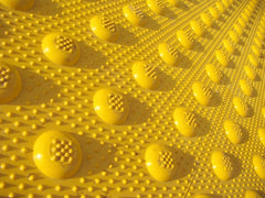 Closeup photo of non-skid pattern used on truncated domes tactile warning tiles and ADA pads