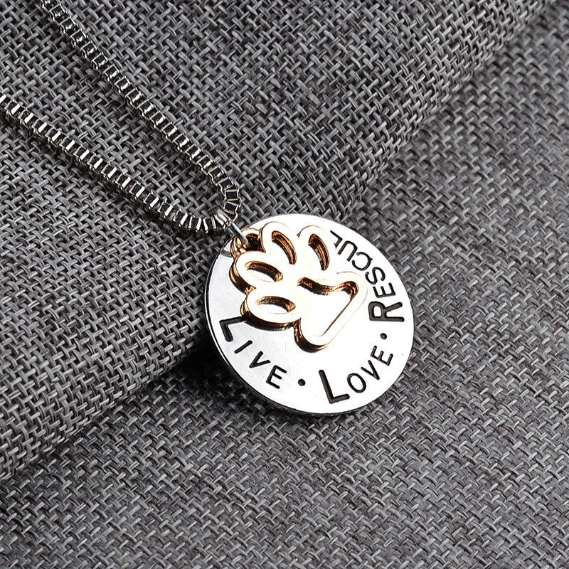 FLFD - LIVE LOVE RESCUE Hollow Gold Paw Pendant Necklace