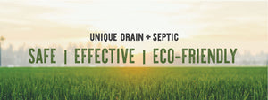 Safe effective eco-friendly septic system treatments and drain cleaners. Unique Drain and Septic. Grass with farm and sunset in the background.