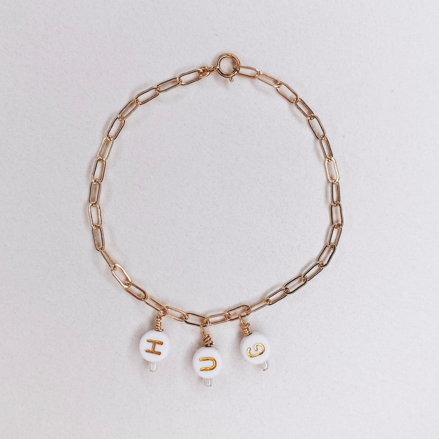 RAQIE Jewelry + Accessories 14K gold fill paperclip chain and letter bracelet