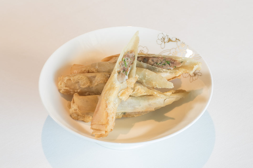Crispy spring roll with goose meat and coriander