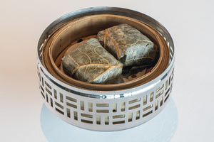 Steamed glutinous rice wrapped in lotus leaf with Cantonese chicken sausage and mushrooms
