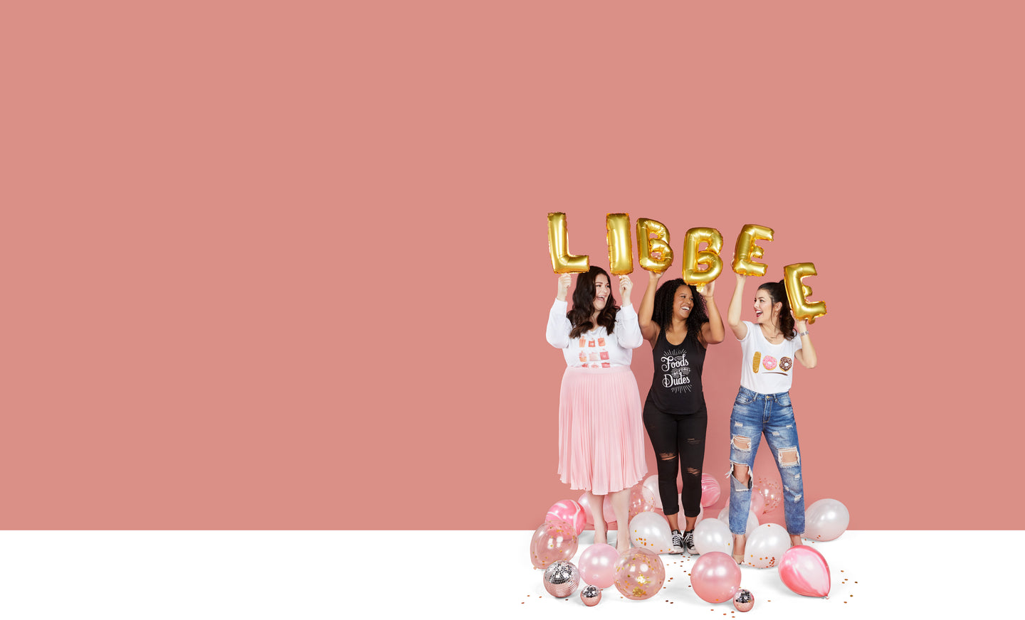 Women with Libbee graphic t-shirts holding Libbee balloons