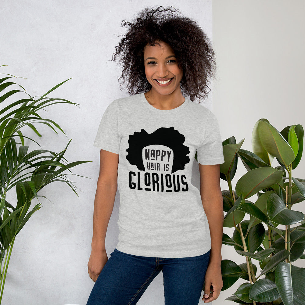 Woman with curly hair wearing a grey tshirt that says Nappy Hair Is Glorious
