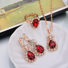 Load image into Gallery viewer, Gold Plated Teardrop Crystal Rhinestone Pendant Necklace, Earrings, and Ring Set