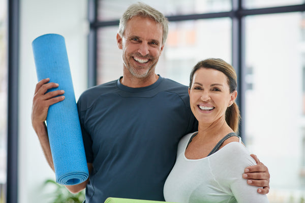 Couple with yoga mat