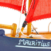 Mauritius-Handmade-Ship-Model-Small Traditional Pirogue - Dark-blue hull with red sail-DodoMarket-Souvenirs