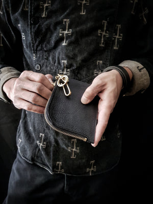 Hanging your Badalassi Zipper Leather Wallet.