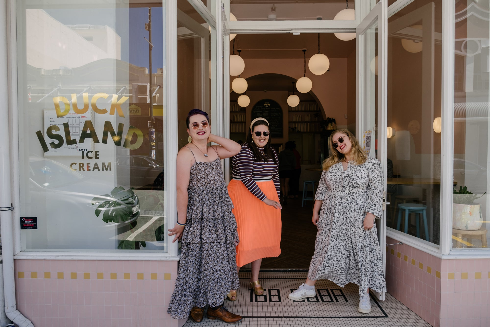 Maxwell, Lucy and Sasha in the same outfits as previous, outside Duck Island Ice Cream shop.