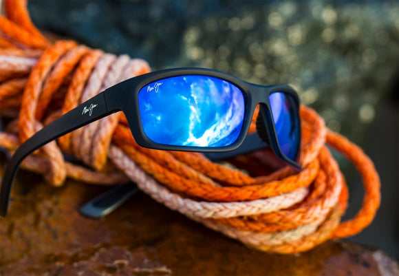 A sunglass entwined in climbing rope