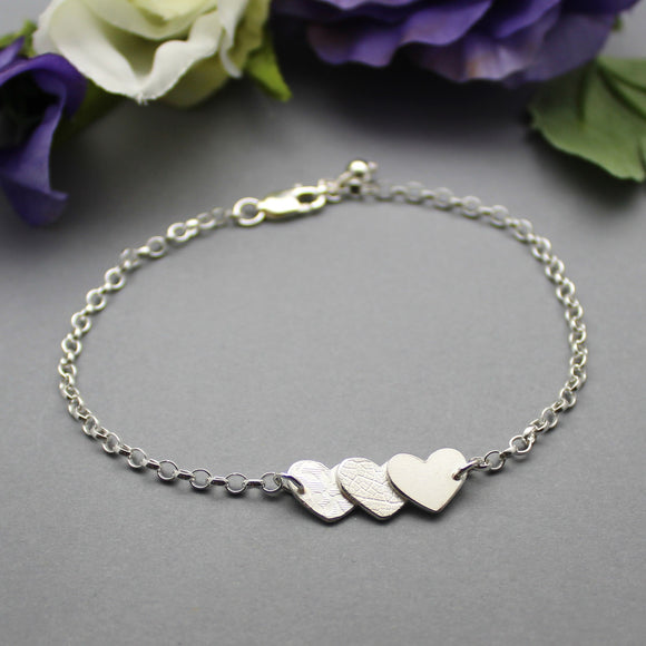 Sterling Silver Triple Textured Hearts Bracelet