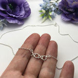 Sterling Silver Hugs And Kisses Necklace