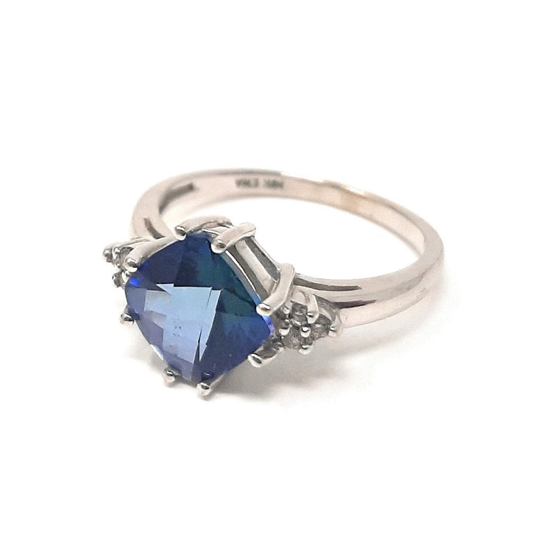 Stunnig Synthetic Sapphire Ring with .10ctw Round Brilliant Cut Diamonds Set In 14K White Gold