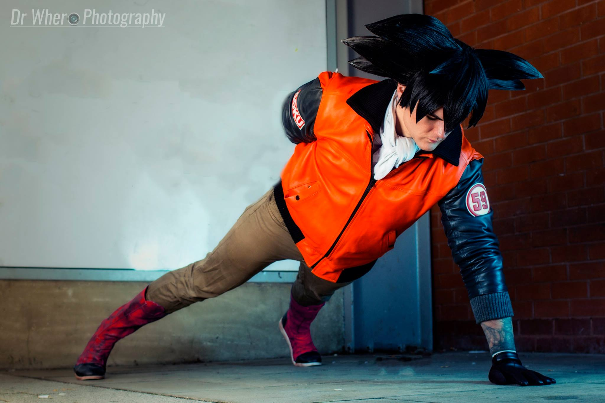 Goku Cosplay From DragonBall Z Wearing His Cell Games 59 Jacket Doing Push Ups