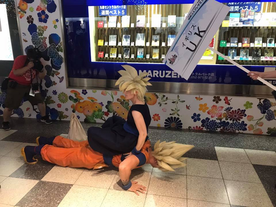 Goku and Gohan cosplayers from DragonBall Z doing push ups during the underground parade at world cosplay summit