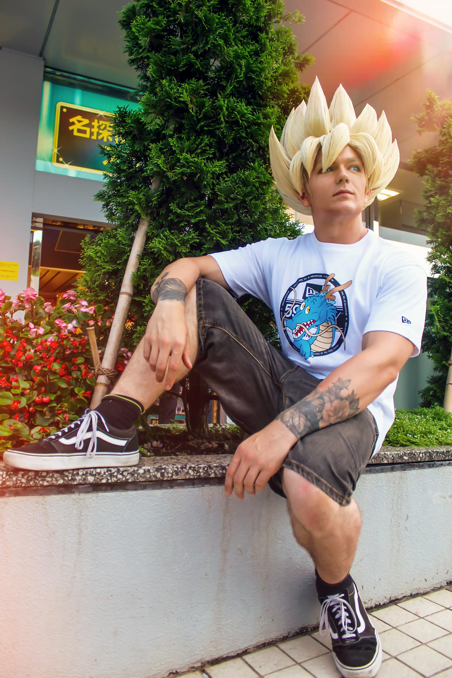 Goku cosplayer relaxing in Tokyo, dragonball x new era jump store collab