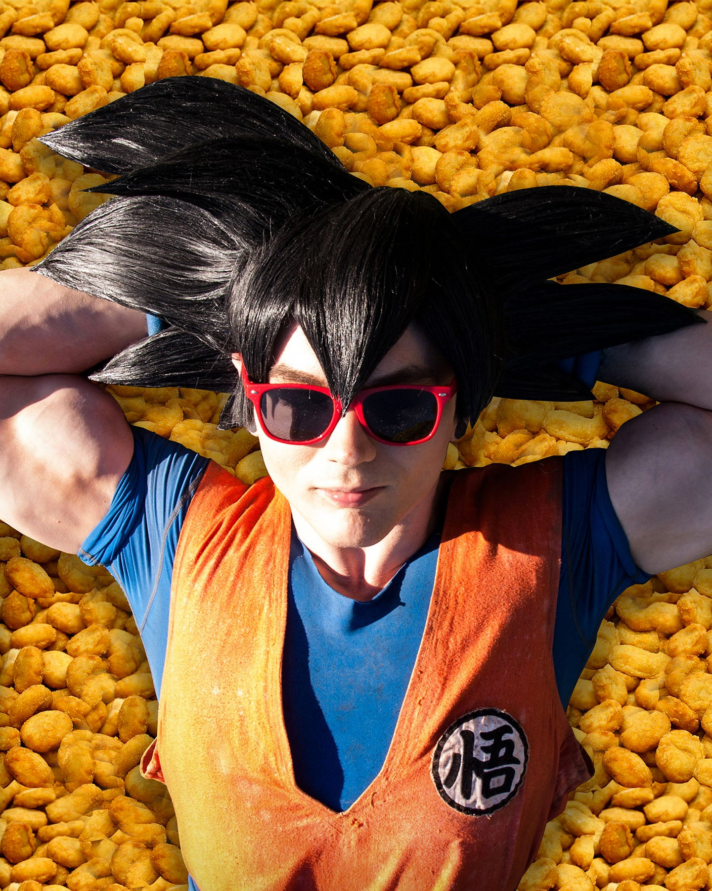 Goku Cosplay From DragonBall Sleeping On A Bed Of Chicken Nuggets