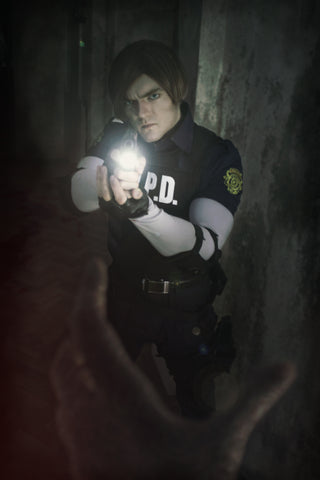 Leon S. Kennedy Resident Evil 2 Remake cosplay shooting a zombie