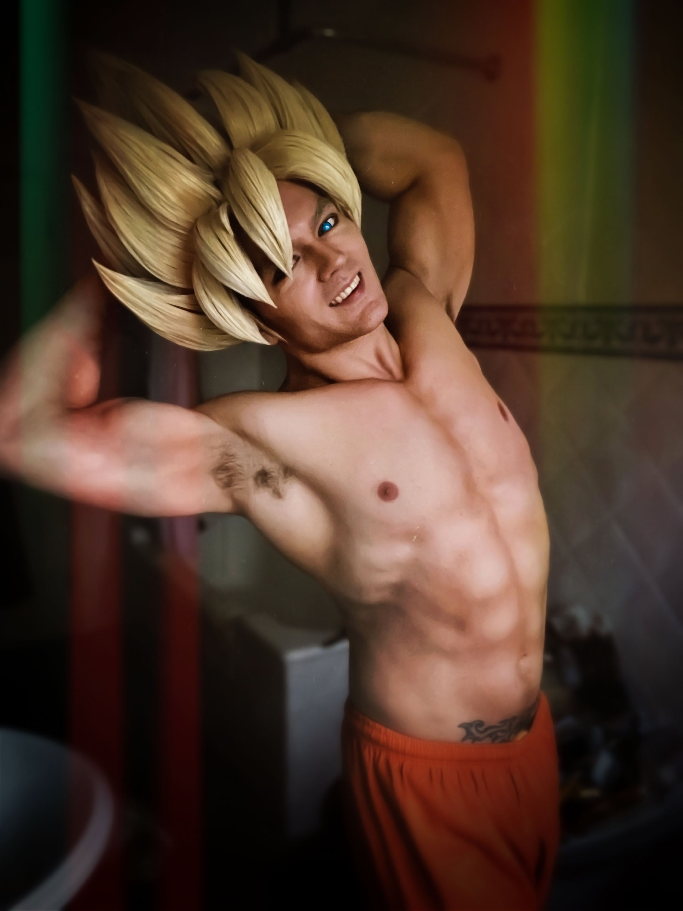 Super Saiyan Son Goku cosplay from DragonBall Z topless and flexing