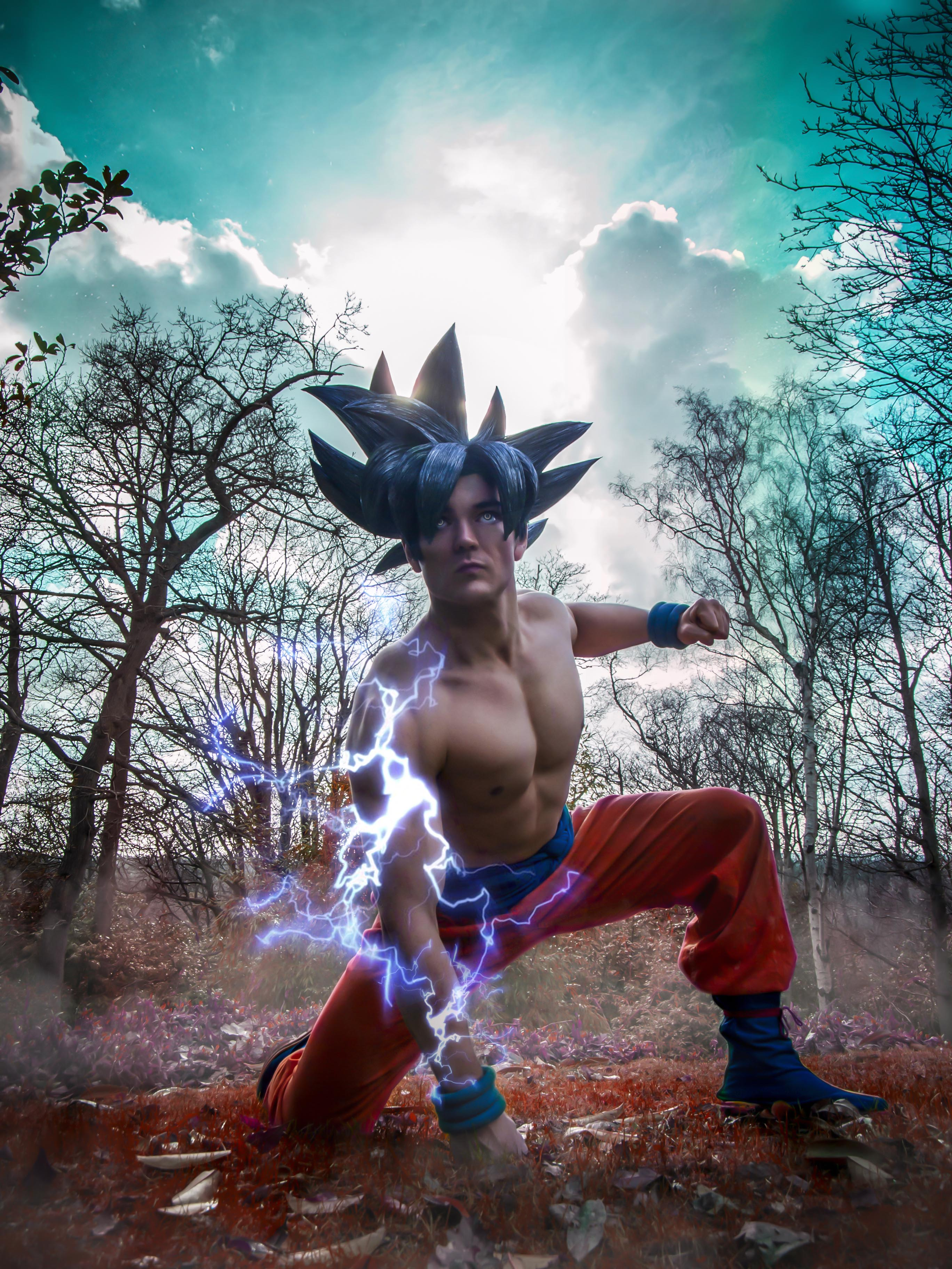 Goku cosplay from dragonball super doing a landing pose