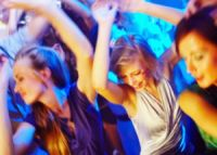 Women Dancing In A Club