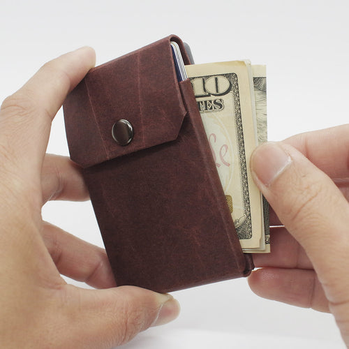 Slim, minimalist, eco-friendly paper wallets that help you live simply. Kamino Card Wallet holds cards, notes, and coins in the smallest profile.