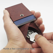 Load image into Gallery viewer, Kamino card wallet holds a few coins and keys.