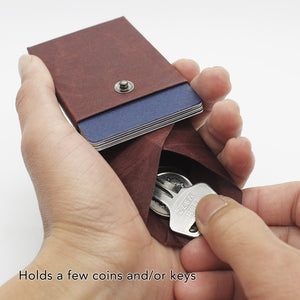 Kamino card wallet holds a few coins and keys.